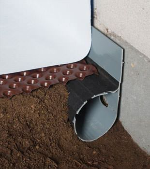 Closeup of a crawl space drainage system installed in Becarra
