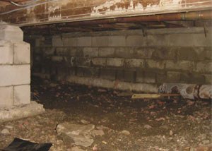 Rotting, decaying crawl space wood damaged over time in Deep Cove