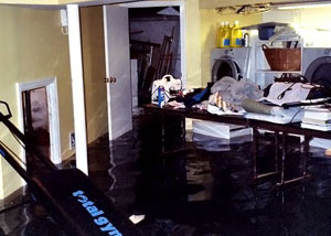 A laundry room flood in West Vancouver, with several feet of water flooded in.