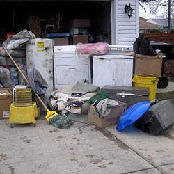 Soaked, wet personal items sitting in a driveway, including a washer and dryer in Chilliwack.