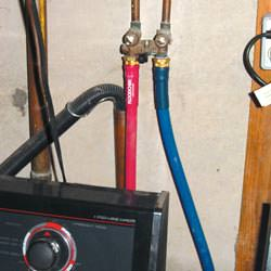 Washer hoses in a basement  in Harrison Hot Springs