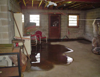 a flooded basement floor in a Anmore home