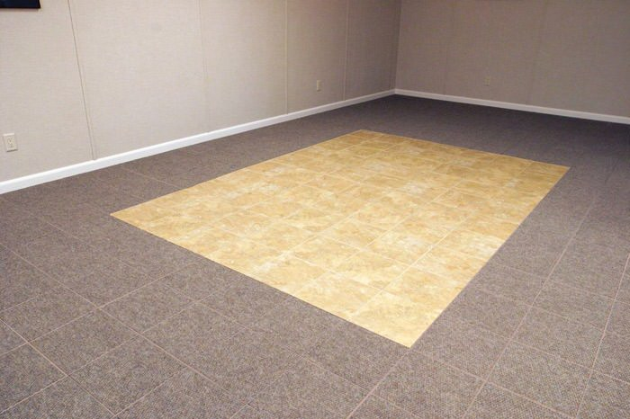 tiled and carpeted basement flooring installed in a North Vancouver home
